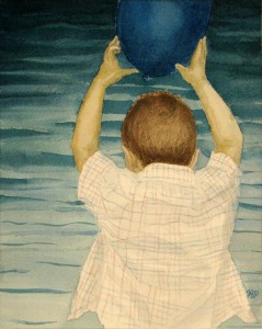 A boy holding a balloon over his head, by a lake