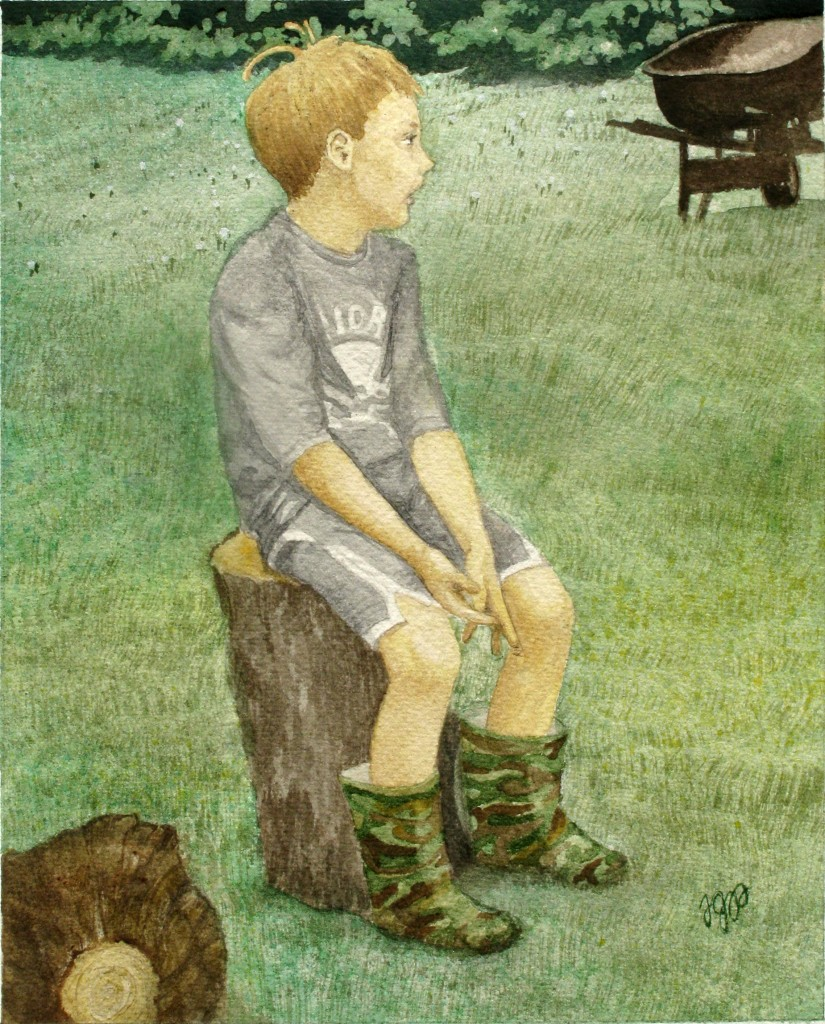 A boy sits on a log