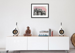 Three Owls framed print displayed on the wall